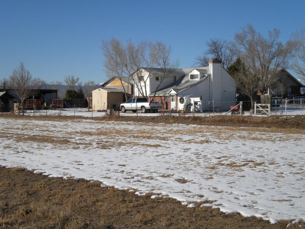 Bucolic scene # 2 -- farm in the distance