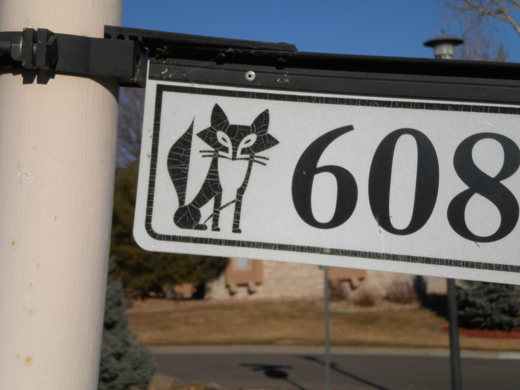 Street number signs throughout the neighborhood