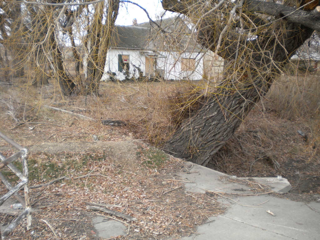 Notice mound of dirt on concrete bridge
