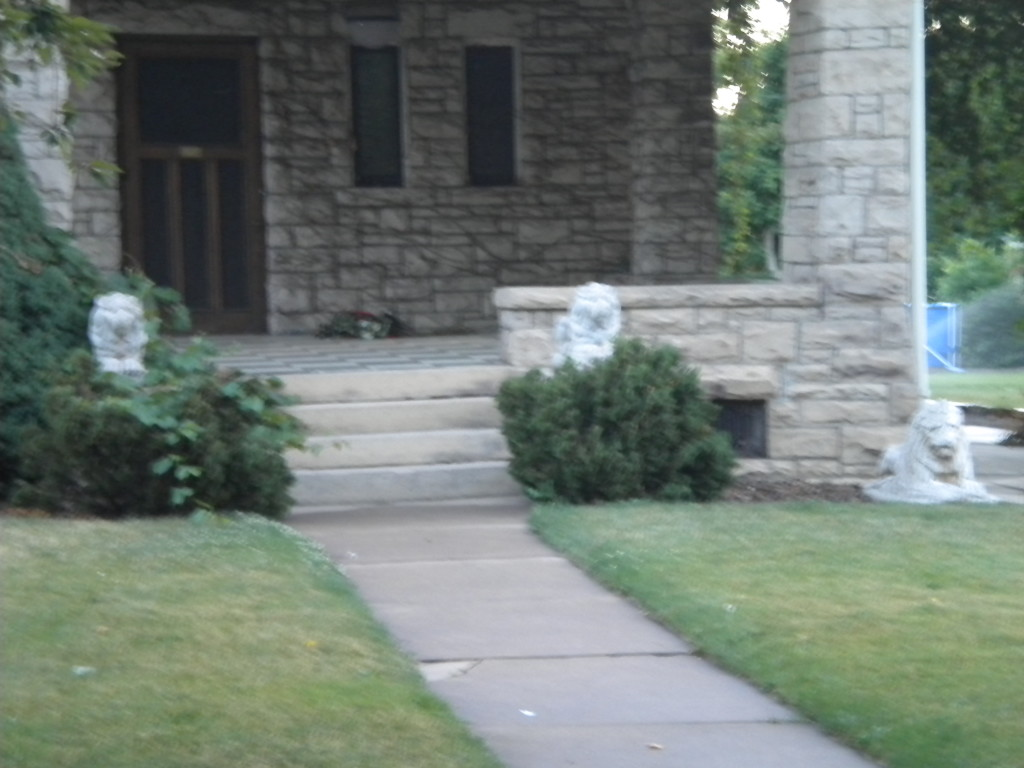 Usually two guard-lions are enough... this house requires three