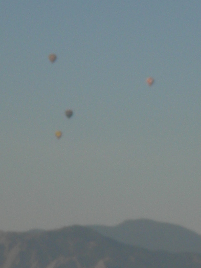 4 hot air balooons over Boulder