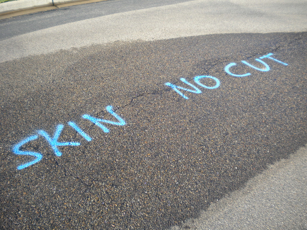 SKIN NO CUT (I'm sure this means something to the road construction workers)