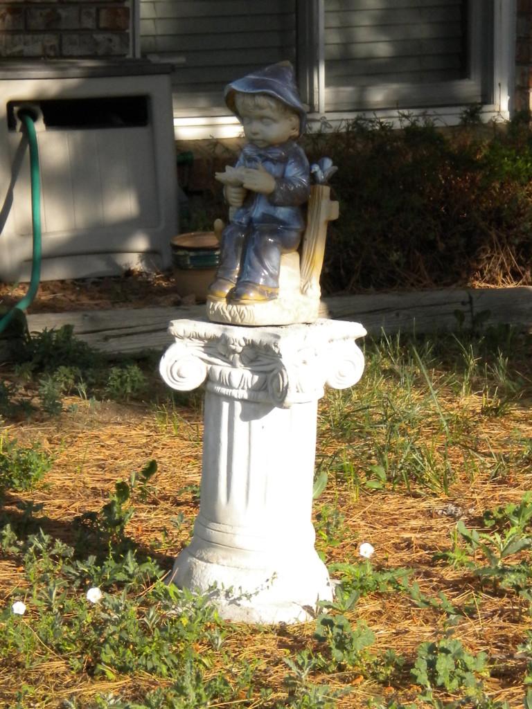 Pedestal statue
