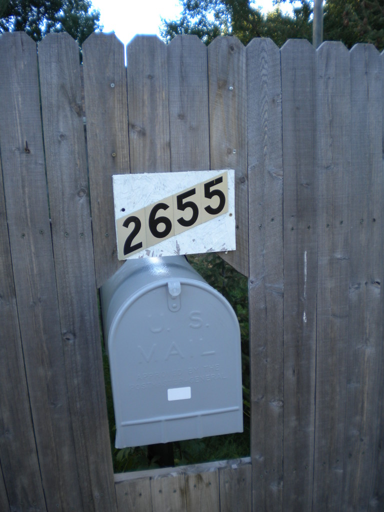 do they have to walk around the fence to get the mail? or is there a backdoor?