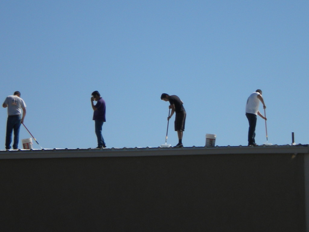 workers on the church roof