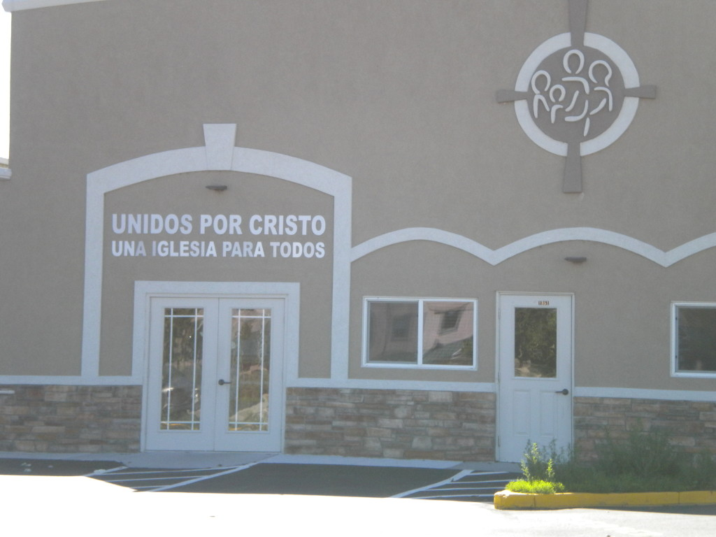 """translates to """"United by Christ  -- a church for everyone"""""""