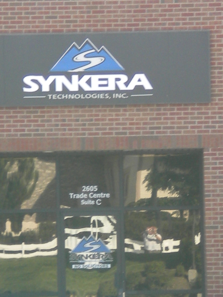 Synkera (with Streetwalker reflection in window)