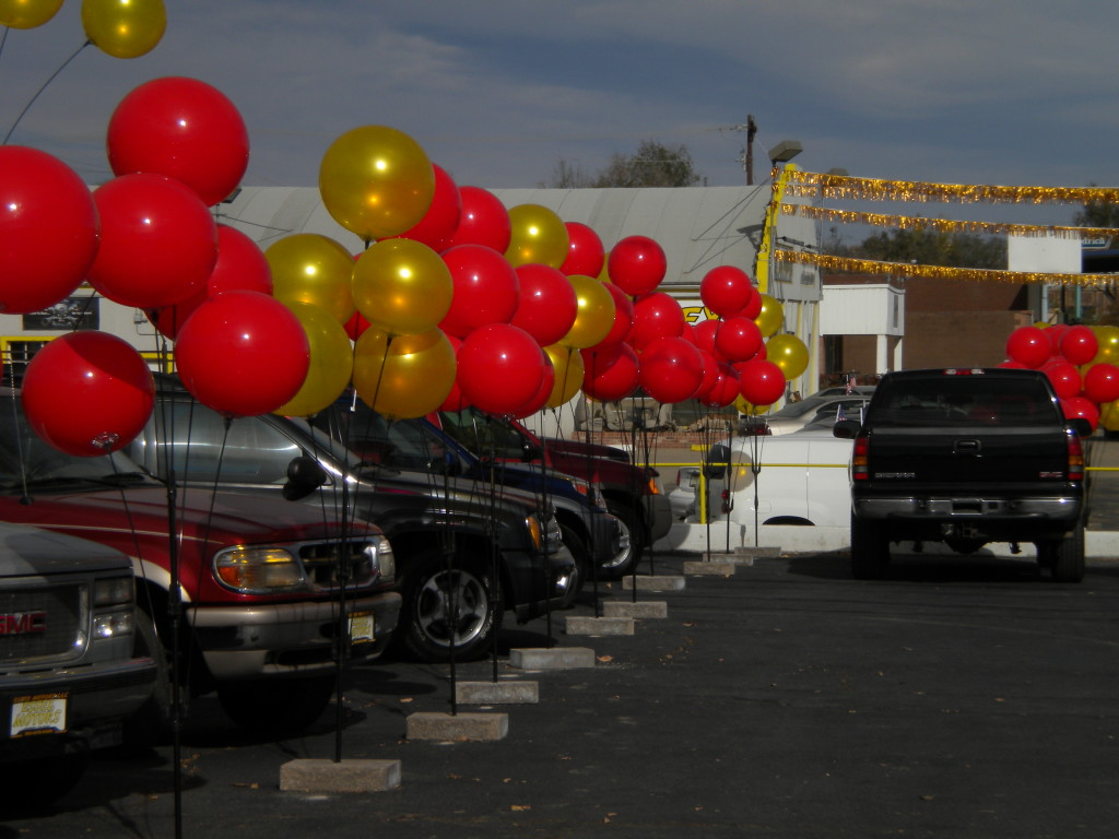 Car lot with Skyline High School colors