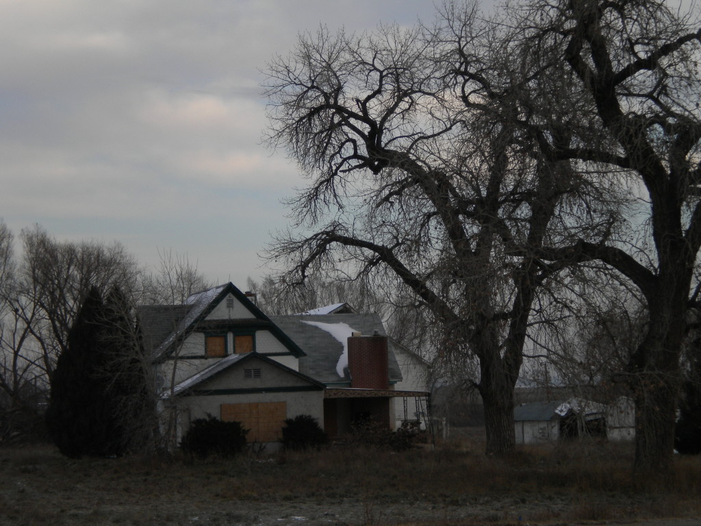 boarded-up farm house