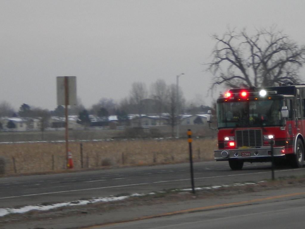 fire truck speeding west toward Longmont
