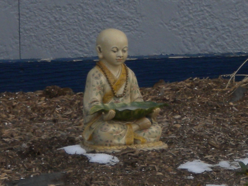 Monk with leaf-bowl?