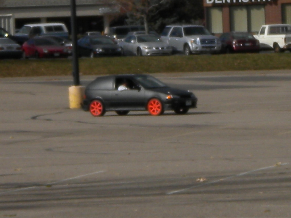 hot rod car in the parking lot